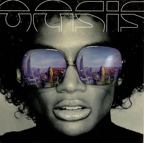 Oasis+Who+Feels+Love+240984