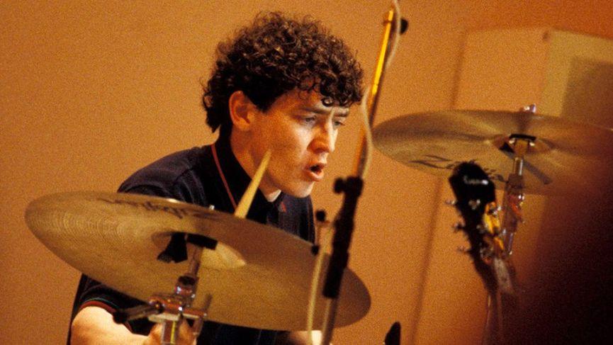Tony McCarroll on drums