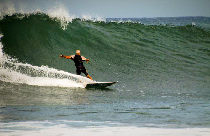 Local board shaper Bruce surfs the Troncones beach break
