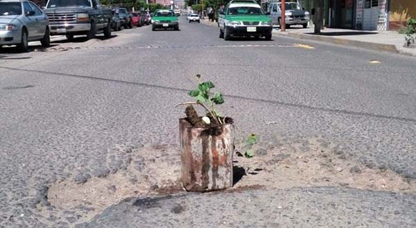 Rezago de baches en Huajuapan sigue siendo atendido