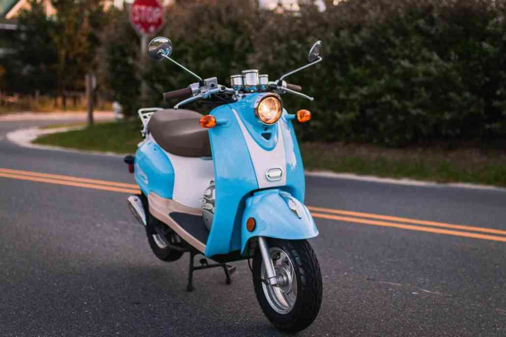 Standalone Side View of blue Scooter