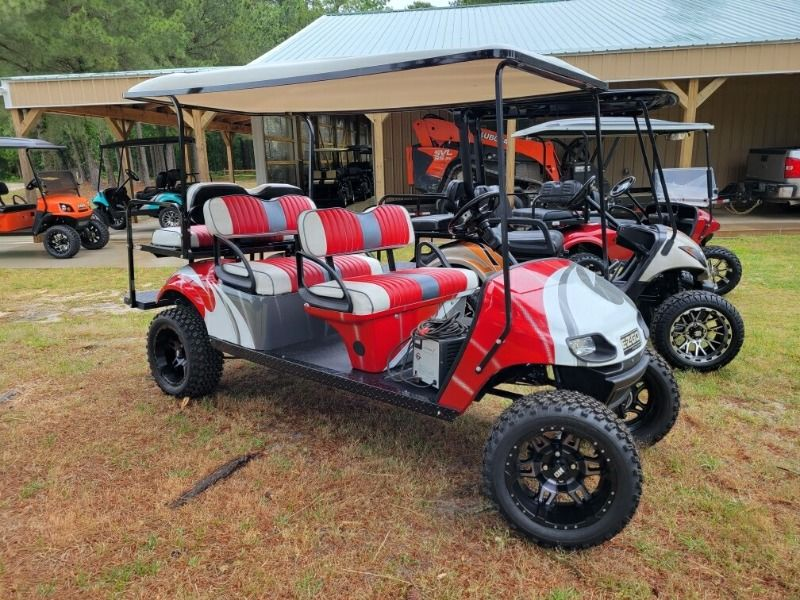 Parked Red 6 Person Golf Cart