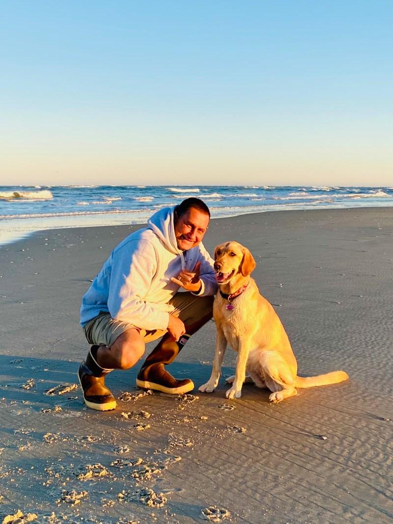 Zak Garcia at the beach with dog