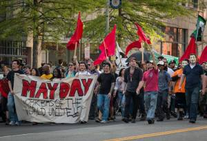 Scott Terry, seen far right, infiltrates the 2014 May Day Parade