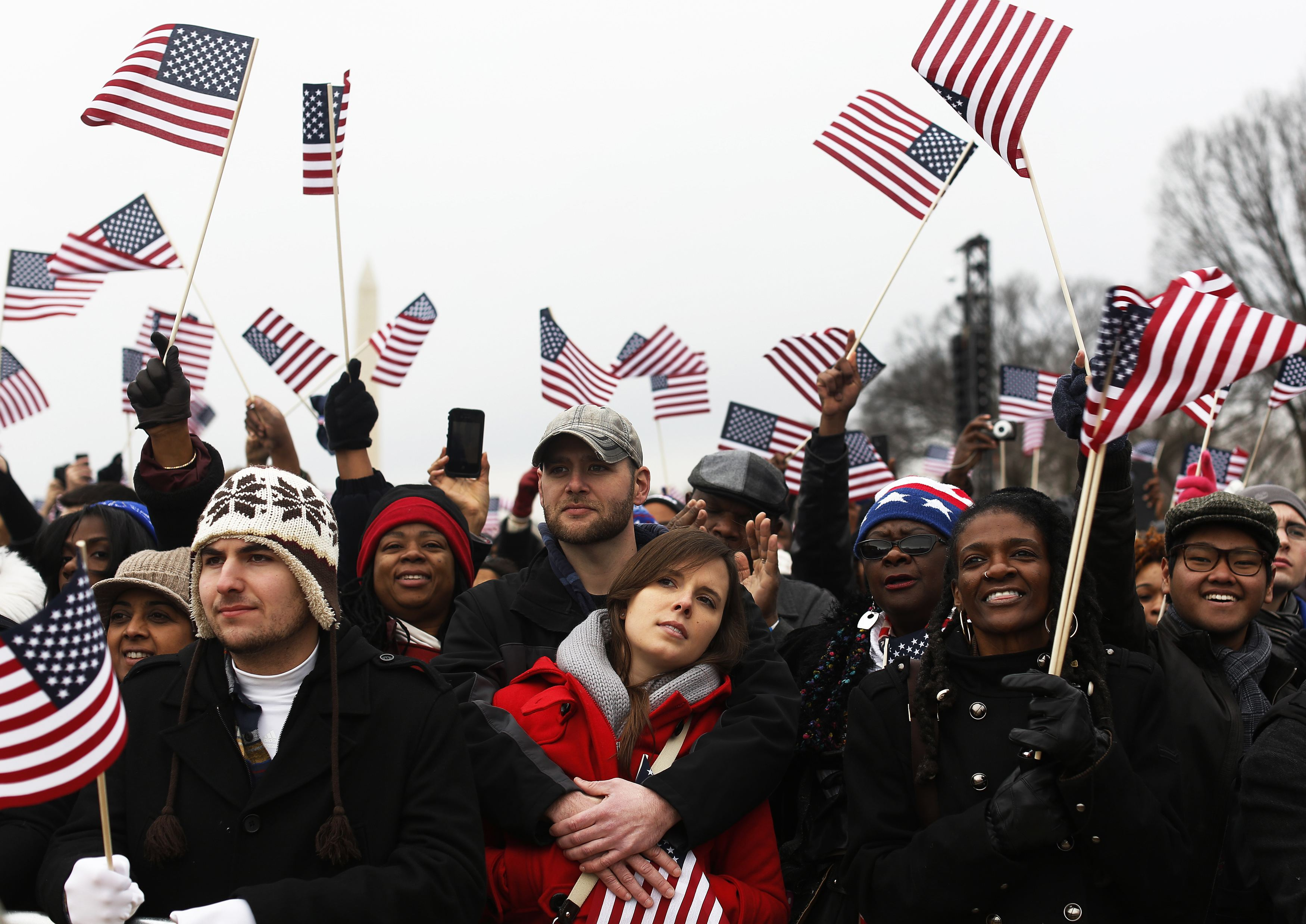 People cheer on the National Mall during the ceremonial swearing-in ceremonies on the West front of the U.S. Capitol in Washington