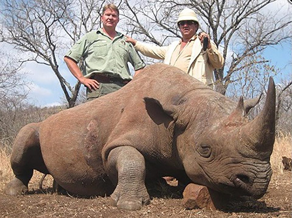 Rashid Sardarov, in pith helmet, poses with a black rhino he shot at John Hume's Mauricedale Game Reserve in Mpumalanga, South Africa. (Photo: Thormählen & Cochran Safaris)
