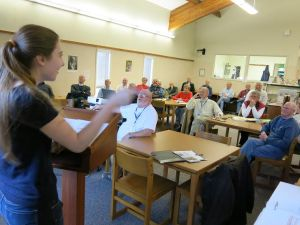 Pentwater High School student Rita Panozzo speaks to the club Dec. 11 about the Community Foundation for Oceana County's strong, positive impact on the community.