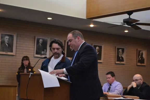 Senovio Garcia, Jr., with his attorney, Timothy Hayes.