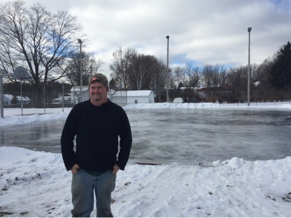 Shelby Village DPW Supervisor Greg MacIntosh stands in front the new ice rink at Getty Park.