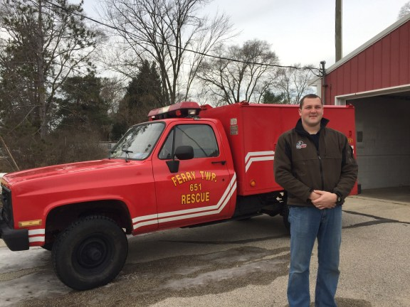 Lt. Chris Ernst of the Ferry Township Fire Department stands in front of the department's new medical rescue unit.