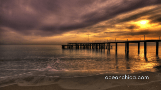 sunset over ocean with pier
