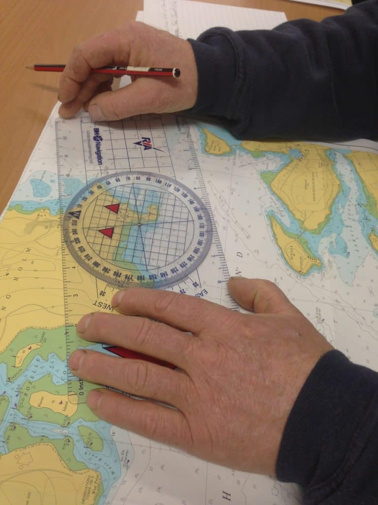 rya basic navigation course - chart with divider and pencil