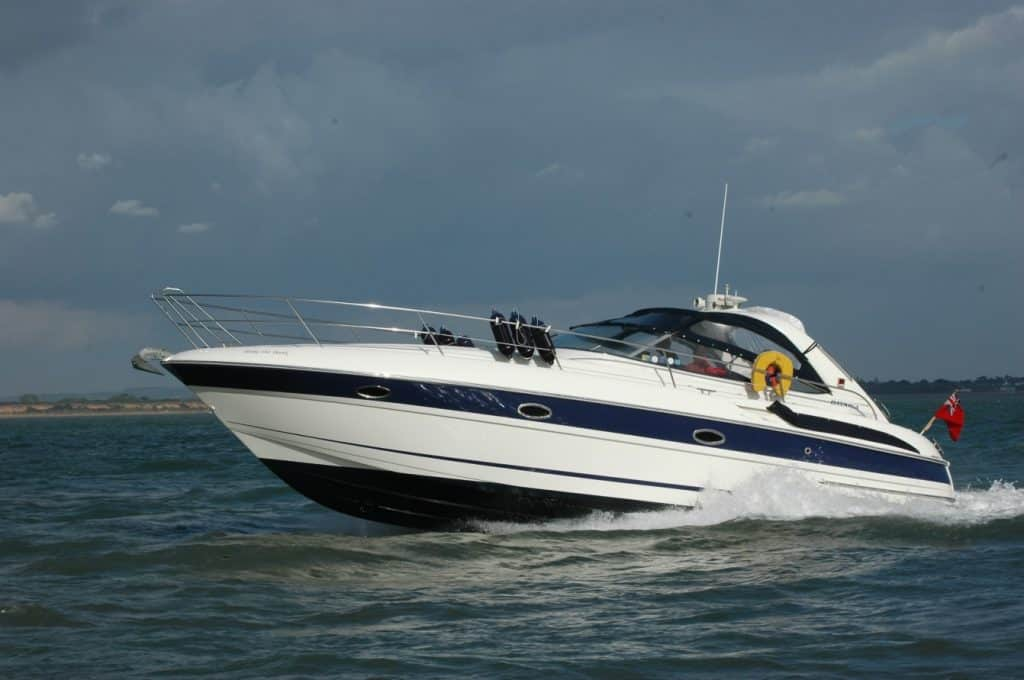bare boat charter Southampton - powerboat travelling with stormy skies in the background