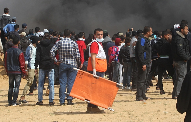 A member of the Palestine Red Crescent Society attends the Great March of Return demonstrations on 27 April 2018 to provide health support to those injured.