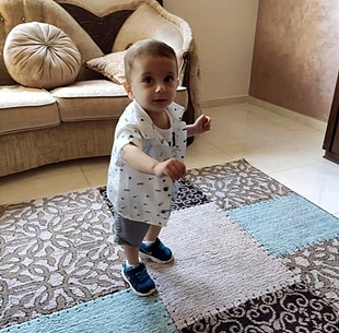 One-year-old Omar was diagnosed with leukaemia in June. Photo by WHO