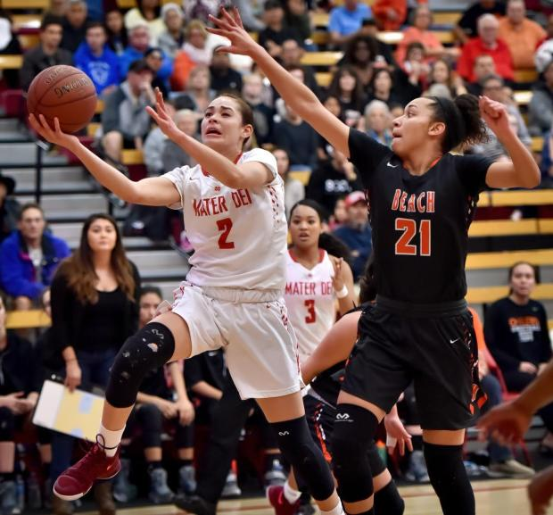 Mater Dei's Jayda Adams leaps for the basket as Huntington Beach's Frankie Wade-Sanc tries to block in the first period of the CIF Southern California Division II Regional playoffs on March 11, 2017, at Mater Dei. (Steven Georges, Contributing Photographer)