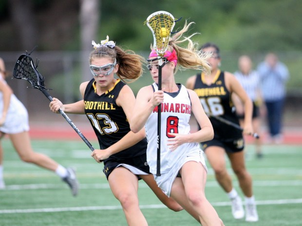 Mater Dei Grace Houser runs with the ball as she goes against Foothill Ava Brand during the first half for the U.S. Lacrosse Orange County championship game at Irvine High School on Wednesday, May 10, 2017. Mater Dei won scoring 13-9. (Photo by Ana P. Gutierrez-Garcia, Contributing Photographer)