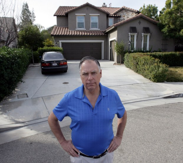 Murrieta resident Geoff Szabo stands in front of his next door neighbor's house that was a drug and alcohol recovery home last year.(File photo by Frank Bellino, THE PRESS-ENTERPRISE/SCNG)
