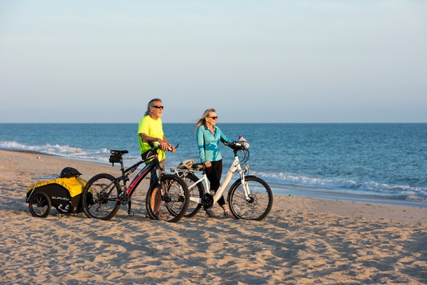 Steve and Sue Koenig of Rancho Santa Margarita take a sunset ride on the beach with their BM Easy Motion bicycles.