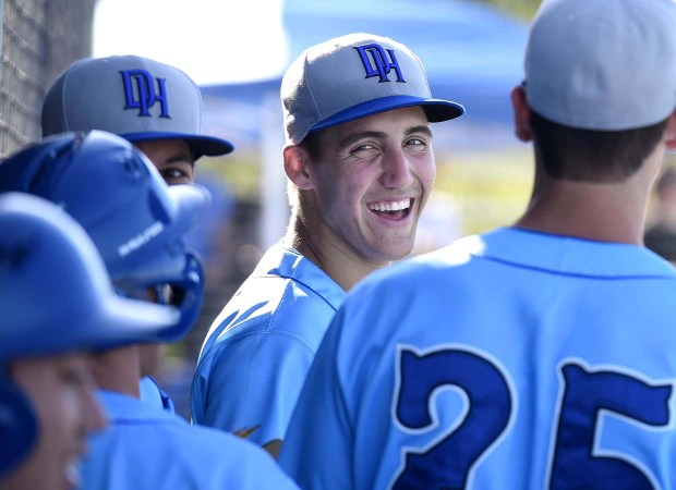 Hans Crouse shares a laugh in the dugout with his teammates from Dana Hills. (Photo by Bill Alkofer, Orange County Register/SCNG)