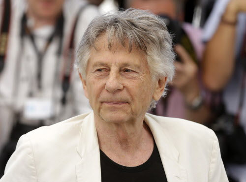 """In this May 27, 2017 photo, director Roman Polanski appears at the photo call for the film, """"Based On A True Story,"""" at the 70th international film festival, Cannes, southern France. (AP Photo/Alastair Grant, File)"""
