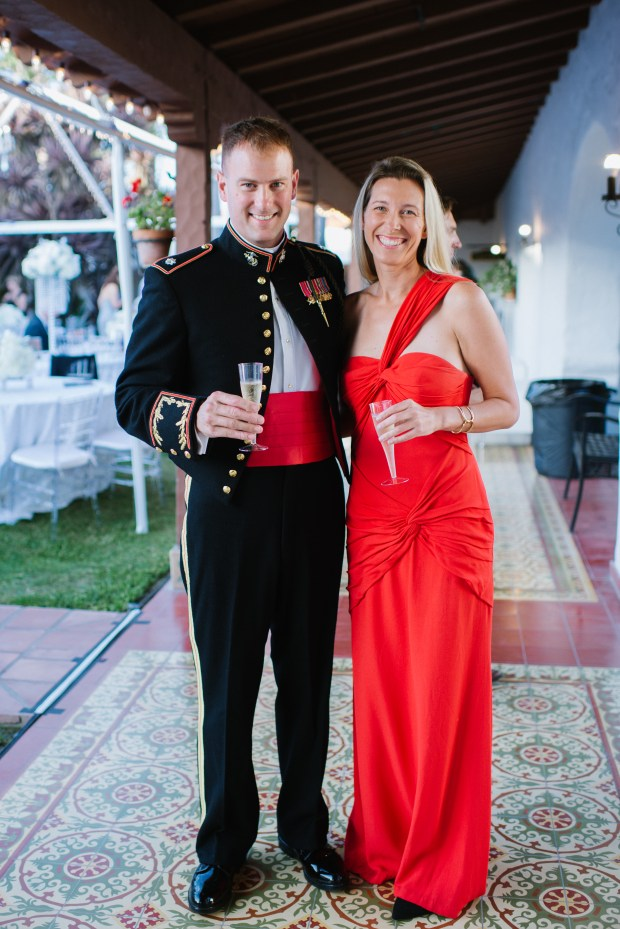 Lieutenant Colonel Warren Cook and his wife Eliza Scott give a champagne toast in the historic courtyard at Casa Romantica.