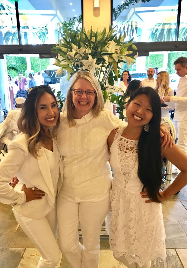 Coast Magazine staff members enjoying Le Diner en Blanc were from left: Samantha Esquivel, Karen Kelso and Jenn Tanaka