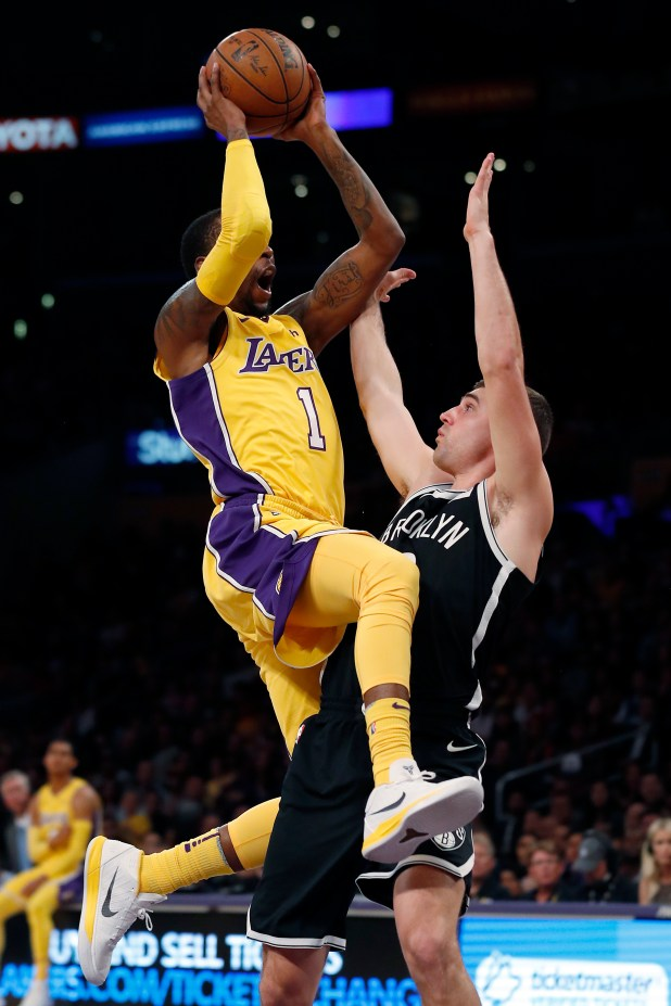Los Angeles Lakers guard Kentavious Caldwell-Pope, left, goes to the basket while being defended by Brooklyn Nets guard Joe Harris during the first half of an NBA basketball game, Friday, Nov. 3, 2017, in Los Angeles. (AP Photo/Ryan Kang)