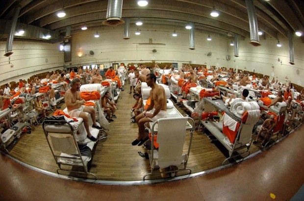 """ORG XMIT: FX103 FILE - In this undated file photo released by the California Department of Corrections, inmates sit in crowded conditions at the California Institute for Men in Chino, Calif. The Supreme Court on Monday, May 23, 2011, endorsed a court order requiring California to cut its prison population by tens of thousands of inmates to improve health care for those who remain behind bars. The court said in a 5-4 decision that the reduction is """"required by the Constitution"""" to correct longstanding violations of inmates' rights. The order mandates a prison population of no more than 110,000 inmates, still far above the system's designed capacity. (AP Photo/California Department of Corrections, File)"""
