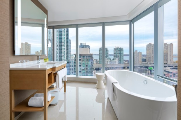 Relax in the soaker tub and enjoy the skyline view at Delta Hotel Toronto Downtown.