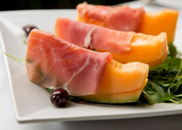Proscuitto d Melone from Sapori Ristorante and Pizzeria in Newport Beach features cantaloupe wrapped with parma prosciutto. (Photo by Leonard Ortiz, Orange County Register/SCNG)