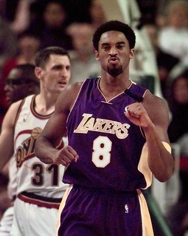new style 6423a 8d197 Los Angeles Lakers  Kobe Bryant (8) turns and heads up-court after drilling  a three-point shot in the first quarter, as Seattle SuperSonics  Brent  Barry ...