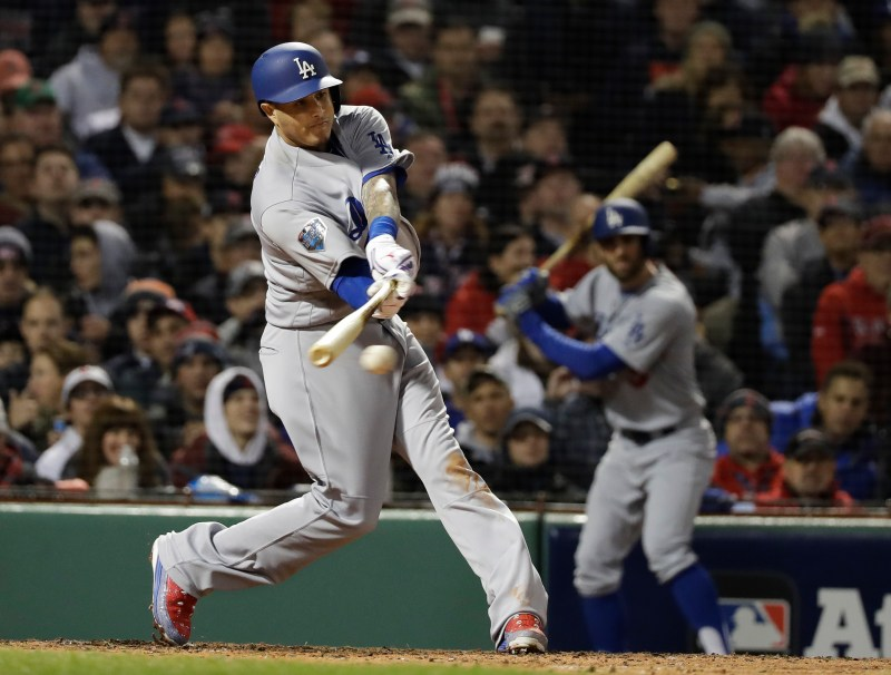431518f75 Los Angeles Dodgers  Manny Machado hits an RBI-single during the third  inning of Game 1 of the World Series baseball game against the Boston Red  Sox Tuesday ...