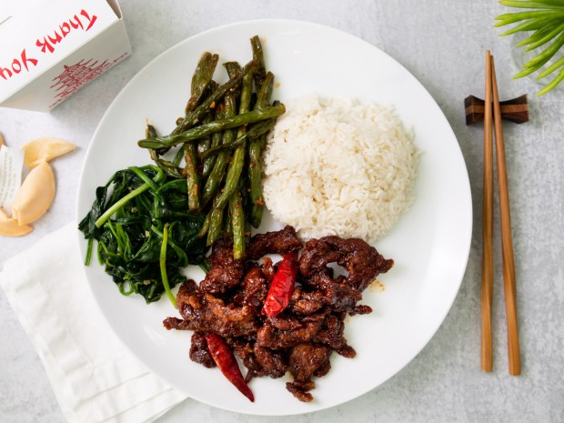Crispy Sichuan beef, string beans and garlic spinach from the new Yang Ming Garden in Villa Park (Photo by Brad A. Johnson, Orange County Register/SCNG)