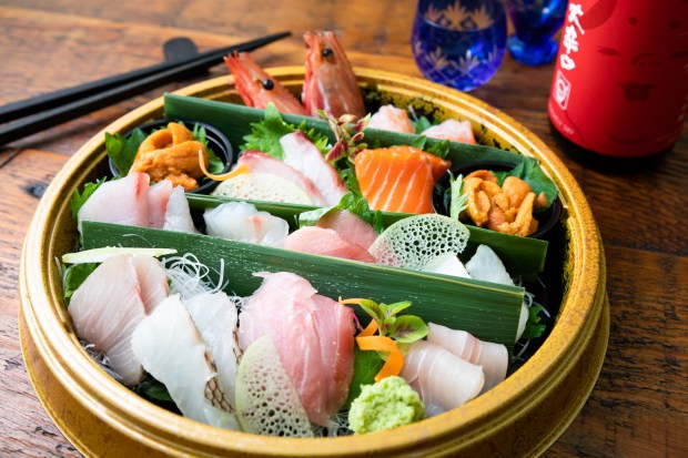 Sashimi and sake to-go from Hana re in Costa Mesa (Photo by Brad A. Johnson, Orange County Register/SCNG)