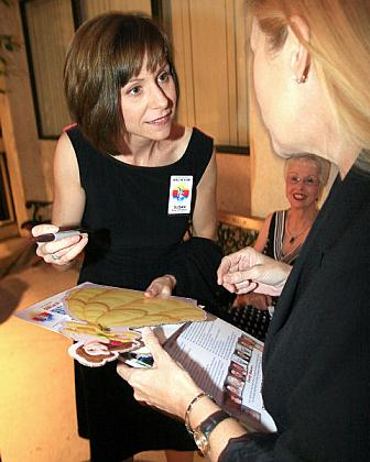 Susan Egan Hartmann signs an autograph prior to the Los Alamitos High School Hall of Fame induction ceremony Wednesday night.