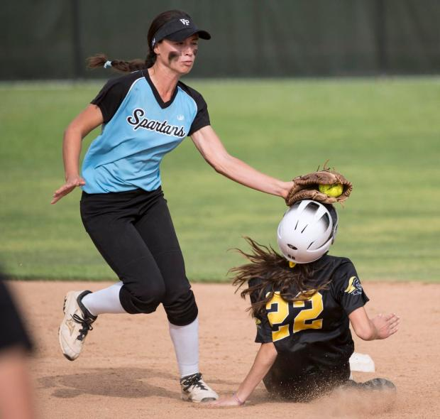Villa Park's Amanda Campos, left, tags Foothill's Madi Hanson's helmet to stop her from stealing second base during a North Hills League game at Villa Park on Tuesday.