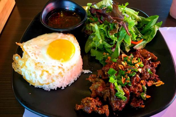 Grilled beef with a fried egg at Q1 Tea Lounge. (Photo by Brad A. Johnson, Orange County Register)