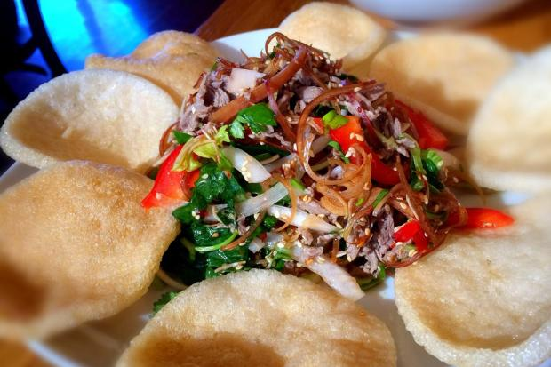 Goi bo, or beef salad, at Quan Hop is made with filet mignon and finely shredded banana blossom, served with rice crackers. (Photo by Brad A. Johnson, Orange County Register)