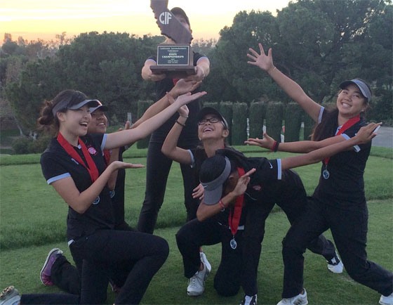 Members of the Troy girls golf team have fun while posing with Beth Lillie and the trophy she received for finishing second in the CIF State Championships on Tuesday in Rancho Cucamonga.