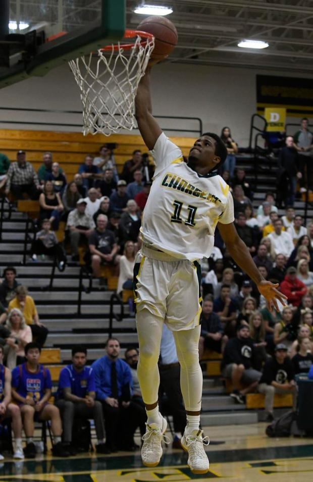Edison's Randall Walker goes up for a one-handed slam dunk Friday. (Photo by Michael Kitada, Contributing Photographer)