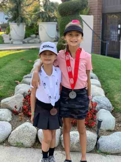 Ontario Christian Principal caddies students at golf tournament.