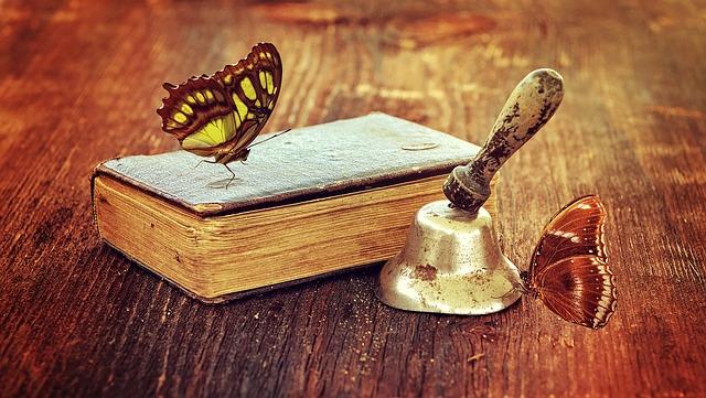 book, butterflies and a bell
