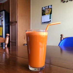 For Wellness Wednesday Linky Party Juicing for Wellness with Orange, pineapple, carrot, celery, ginger - www.OddsandEvans.com