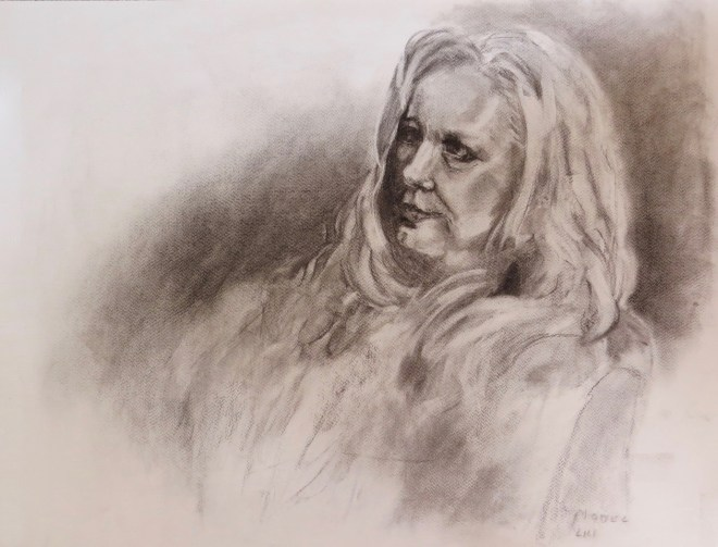 A charcoal drawing of a woman by Odette Laroche in Sidney, BC.