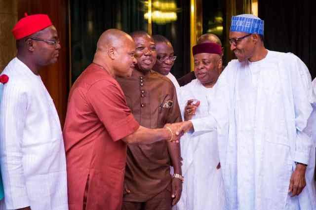Buhari exchanging pleasantries with some of the delegates from southeast