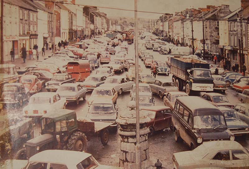 THIS IMAGE OF CASTLEISLAND IN 1974 (PROPERTY OF TOMO BURKE AND WORK OF TIMOTHY MURPHY) ONCE ADORNED THE WALL OF THE BANK OF IRELAND