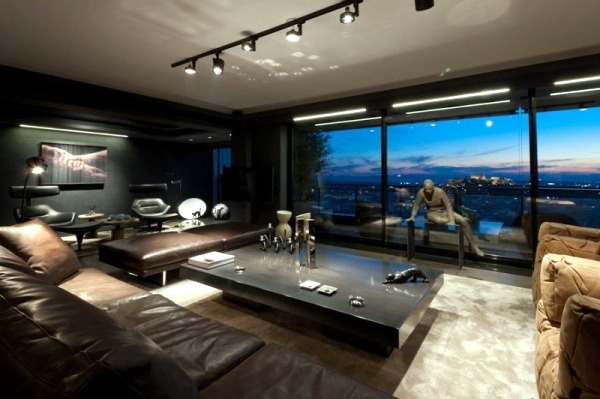 Leather furniture and works of art characterize a luxury apartment         designed by Studio Omerta in Athens  Greece  The apartment has stunning  views of the ancient Greek acropolis and its interior design combines art  with