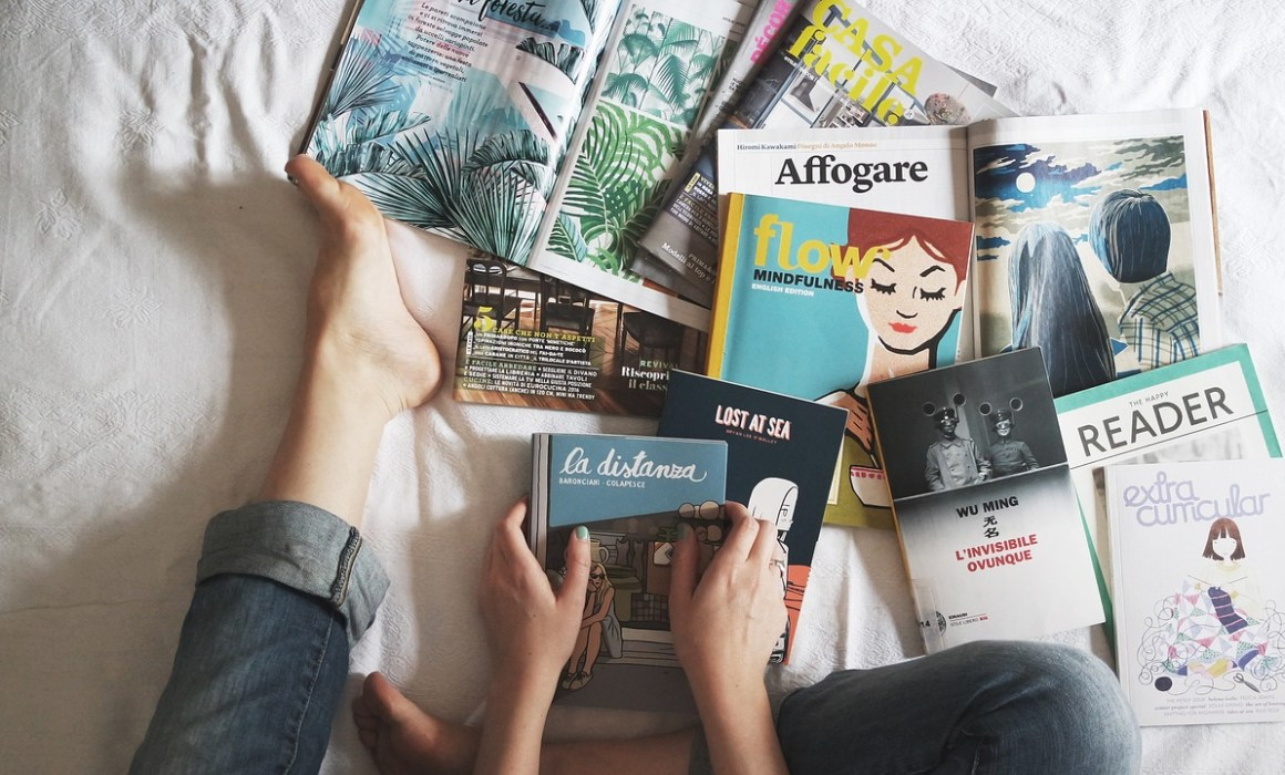 Reading books on the bed
