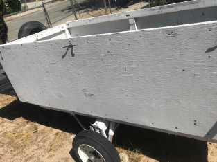 utility trailer pink slip in hand with toolbox